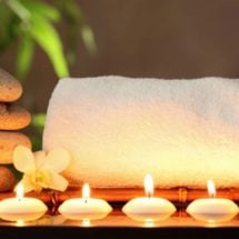 candles-and-towel-154418691-910x513